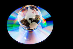 Earth globe on compact disk. As symbol of global technology and information Royalty Free Stock Photography