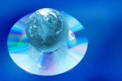 Earth globe on compact disk. As symbol global technology and information Royalty Free Stock Images