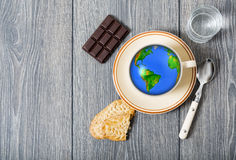 Earth globe  cup of coffee Royalty Free Stock Images