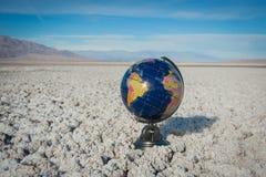 Earth Globe In Desert Waste Royalty Free Stock Photos