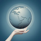 Earth globe into female hand Stock Images