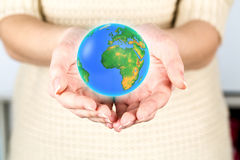 Earth globe female hands Stock Photos