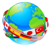 A earth globe with flags of countries. A conceptual illustration of a globe with the flags of lots of countries flying around it Royalty Free Stock Photo