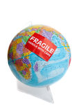Earth globe with a fragile sticker Stock Photo