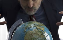 Earth globe  and greedy man. Narcissism, Greed and Power concept with earth globe over white background Stock Photography