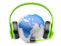Earth globe with green headphones and microphone Stock Photography