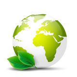 Earth globe with green leaves. On a white background Royalty Free Stock Images