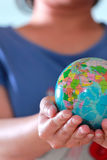 Earth globe in hand Stock Image