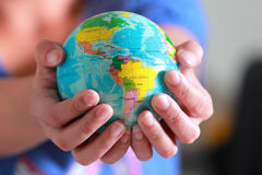 Earth globe in hand Royalty Free Stock Photography
