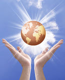 Earth globe in hands Stock Photography