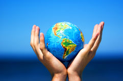 Earth globe in hands. Conceptual image Stock Photography