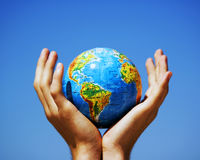 Earth globe in hands. Conceptual image Royalty Free Stock Photo