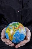 Earth globe in hands. Conceptual image stock photos