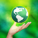 Earth globe in his hands Stock Photo