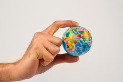Earth globe in his hands Royalty Free Stock Image