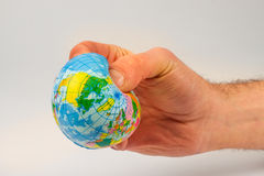 Earth globe in his hands Stock Photos