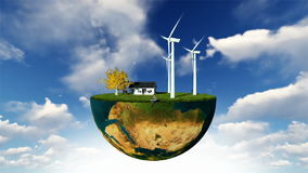 Earth globe holding wind turbines and happy family against blue sky stock video footage