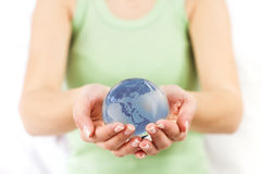 Earth Globe in Human Hands Stock Photography