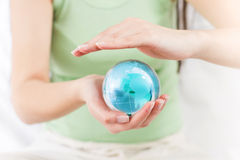 Earth Globe in Human Hands Royalty Free Stock Image