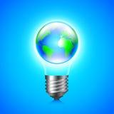 Earth globe inside light bulb environment concept Stock Photos