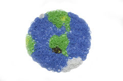 Earth globe. Made of Rainbow Loom bands Stock Image