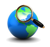 Earth globe with magnify glass Royalty Free Stock Photos