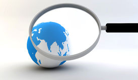 Earth globe with magnifying glass Stock Photography