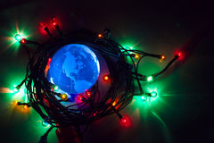 Earth globe North America Christmas background. Earth globe North America with Christmas background blue is dominant stock images