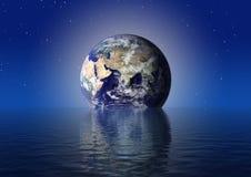 Earth globe. Over the night sea Royalty Free Stock Photos