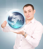 Earth globe on the palms of his hands Stock Image