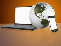 Earth Globe, phone and laptop Royalty Free Stock Photography