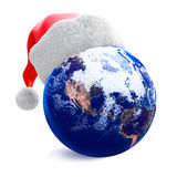 Earth globe and santa hat Royalty Free Stock Photography