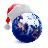 Earth globe and santa hat vector illustration