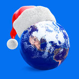 Earth globe and santa hat Stock Photo