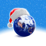 Earth globe and santa hat Stock Photos