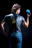 Earth globe in save hand of man. With body art on back standing isolated on black background Stock Photography