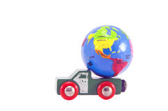 Earth globe small model and car toy truck concept. Earth globe small model and car toy truck isolated on white. Future concept Stock Photo