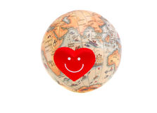 Earth globe with small red heart Stock Images