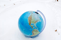 Earth globe sphere winter snow snowbank concept. Earth globe sphere lie stand in winter snow snowbank royalty free stock photos