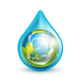 Earth globe in water droplet isolated Stock Photo