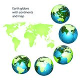 Earth globes with green continents Royalty Free Stock Photos