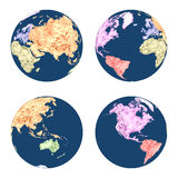 Earth globes in polygonal style colored by continents in different positions Stock Photography