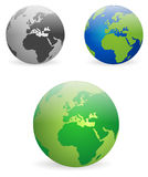 Earth globes - vectors. Illustration representing glossy earth globes in various colours Royalty Free Stock Photos