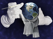 Earth in gloved hands  Stock Photography