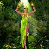 Earth Goddess. A sensual Earth Goddess standing amongst plants with her arms raised and mystical lights illuminating the scene. Her green dress and bare feet Stock Images