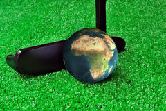 Earth Golf. Playing Golf With Planet Earth Stock Photo