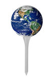 Earth on golf tee. Isolated over a white background stock photography