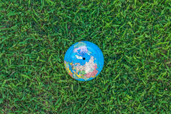 Earth In Grass Stock Photo