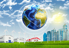 Earth, grass, skyscrapers and industrial area Stock Image
