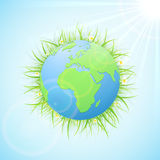 Earth with grass and Sun Royalty Free Stock Photo